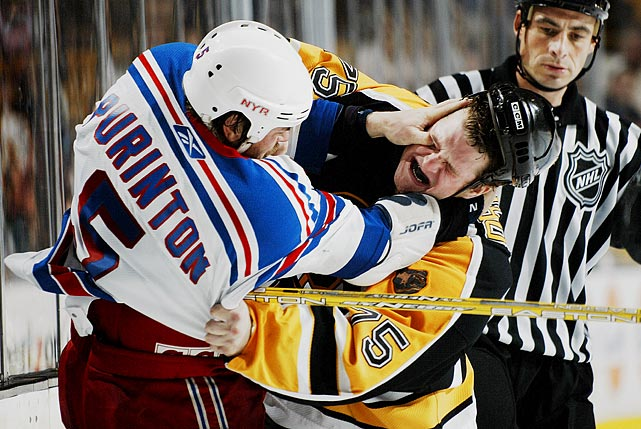 Rangers defenseman Dale Purinton fights with Bruins right wing Colton Orr during a preseason game.