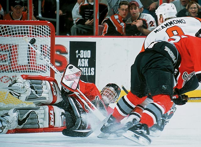 Sabres goalie Dominik Hasek makes a stick save on a shot by Flyers center Dean McAmmond during overtime of Game 2 of their Eastern Conference Quaterfinals.