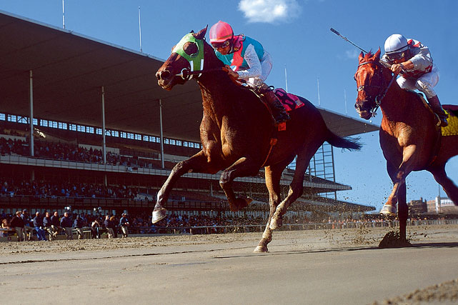 Jockey Jerry Bailey takes Empire Maker to the wire past jockey Jose Santos and Funny Cide in winning the 2003 Wood Memorial at Aqueduct.