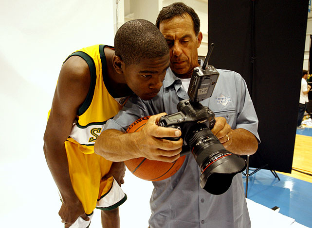 Sports Illustrated photographer Lou Capozzola, seen here with Kevin Durant, passed away at age 61 on Aug. 18.  Lou began his career at SI in 1980 and shot countless hockey games, among other sports, for the brand.  Here's a sample of some of his most memorable photographs.