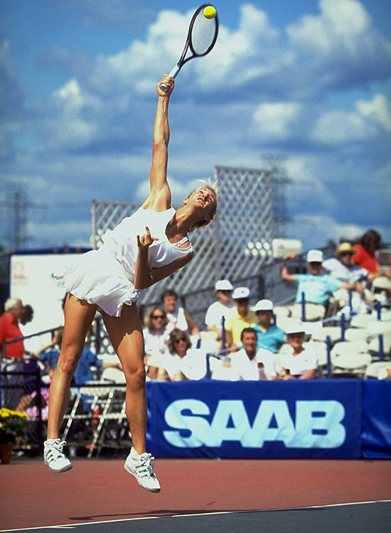 Mary Pierce serves during the Pathmark Open.