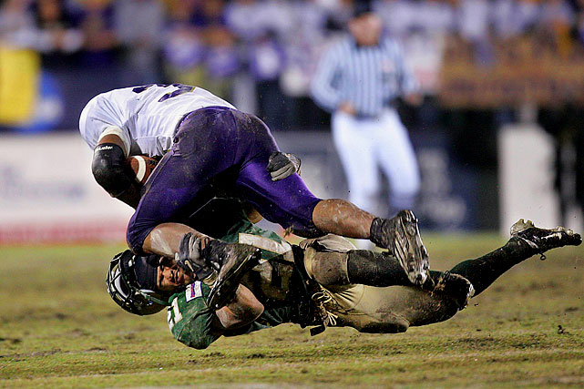 William and Mary defensive back James Miller takes a licking from James Madison tail back Maurice Fenner in the third quarter of James Madison's 48-34 victory in their NCAA 1AA Semifinal game.