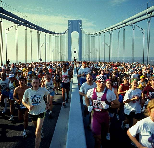 A huge pack of runners cross the Verrazano-Narrows Bridge at the beginning of the New York City Marathon.