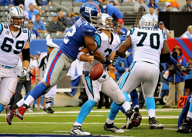 Giants defensive end Osi Umenyiora sacks Panthers quarterback Matt Moore, forcing a fumble.