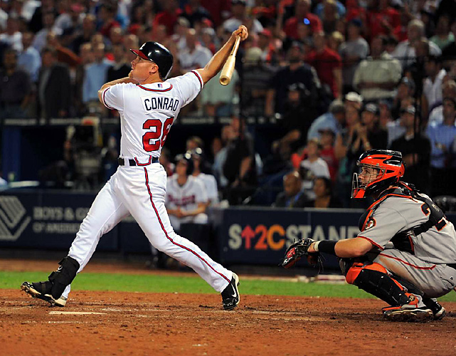 "Conrad's ""super walk-off slam"" capped a seven-run ninth in the Braves' 10-9 victory over the Reds."
