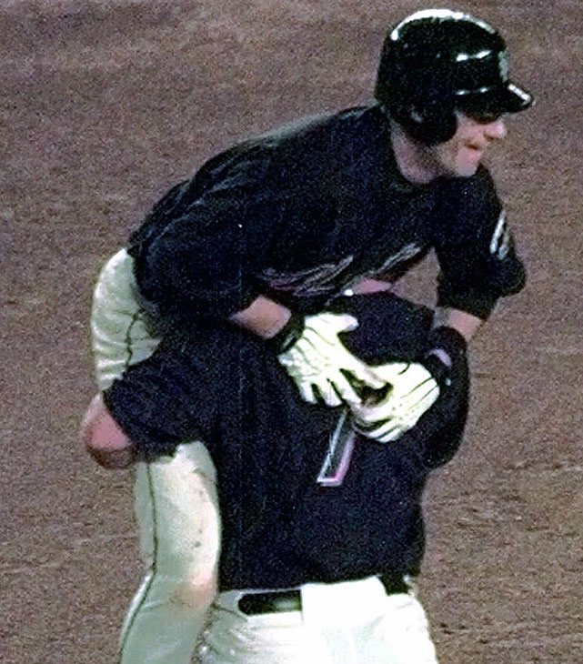 "Ventura's walk-off ""grand single"" gave the Mets a 4-3 win over the Braves in Game 5 of their NLCS. Ventura was rounding the bases after hitting a pitch over the wall when Todd Pratt, the runner who was on first, picked up Ventura (shown) in celebration. Subsequently, Ventura was mobbed by his teammates, never finishing his trot around the bases. Because he failed to touch all four bases, the hit was officially scored a single."