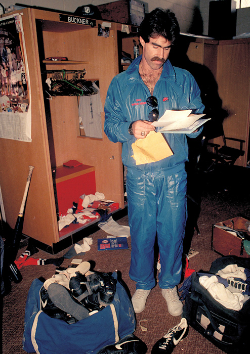 Bill Buckner reads some mail as he clears out his locker at Fenway Park one day after the Red Sox lost the World Series.
