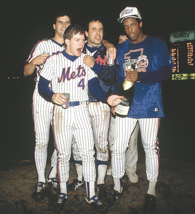Lenny Dykstra celebrates with Rick Aguilera, Bob Ojeda and Dwight Gooden after winning Game 7.