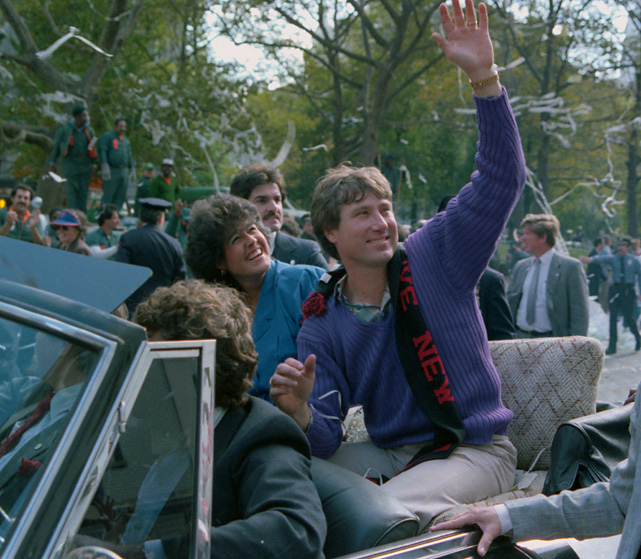 Third baseman Ray Knight, who was named World Series MVP, waves to crowds of New Yorkers during the championship parade.