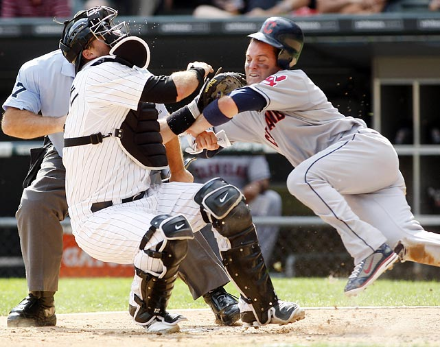 The Indians' Trevor Crowe is tagged out as he collides with White Sox catcher A.J. Pierzynski.