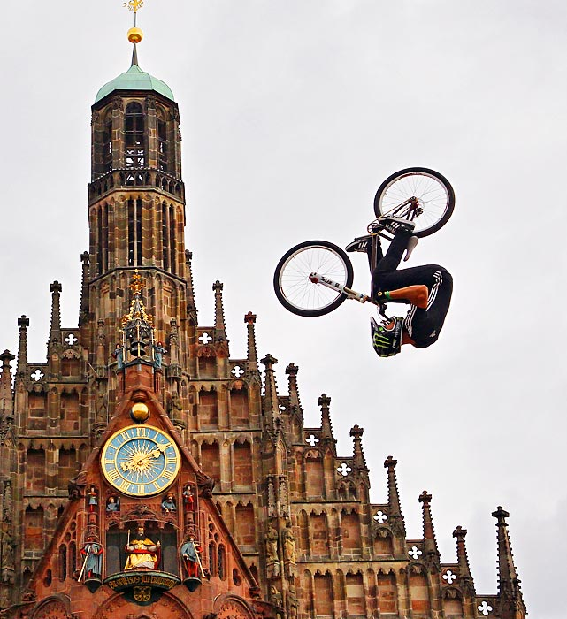 A professional cyclist jumps over a church in Nuremberg, Germany, during a freeriders' race in the historic city center. He safely avoided the church's spires, in case you were wondering.