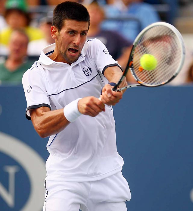 Novak Djokovic pounds a backhand during the early round of the 2011 U.S. Open. The No. 1 seed beat No. 2 seed Rafael Nadal, in the finals to cap off what John McEnroe called the best ever tennis season.