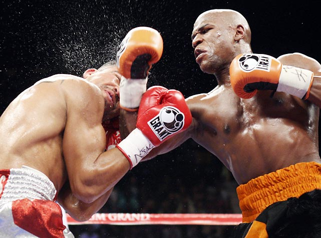 Floyd Mayweather has done it again. Some are calling his fourth-round knockout of Victor Ortiz (left) cheap and controversial, but Mayweather remains undefeated.