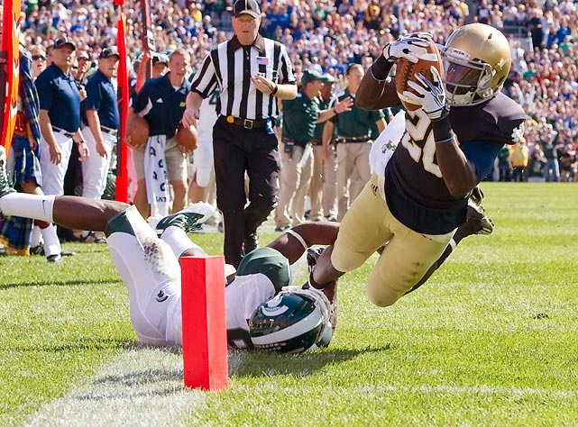 Notre Dame running back Cierre Woods stretches the ball across the pylon in a 31-13 home upset of Michigan State. Woods had 61 yards rushing and two touchdowns.