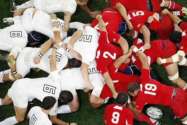 The ball is in there somewhere! English (left) and Georgian (right) rugby squads formed this scrum during the Rugby World Cup in Dunedin, New Zealand.
