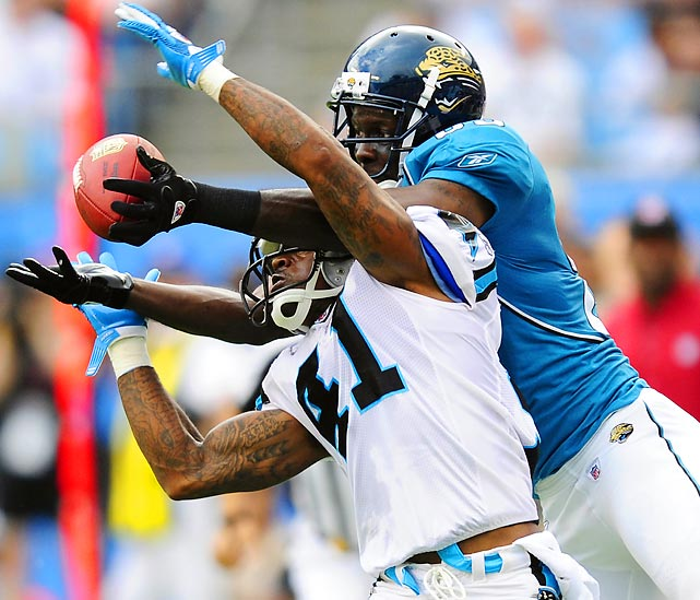 Panthers' defensive back Captain Munnerlyn breaks up a pass intended for Jags' receiver Jason Hill. The Panthers picked up the win in a battle between two winless teams starting rookie quarterbacks.