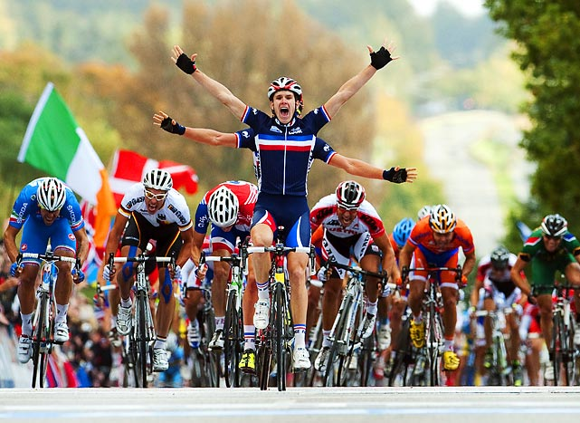 No Arnaud Demare does not have four arms. He is celebrating with teammate Adrien Peti at the UCI Cycling Road World Championships in Copenhagen.