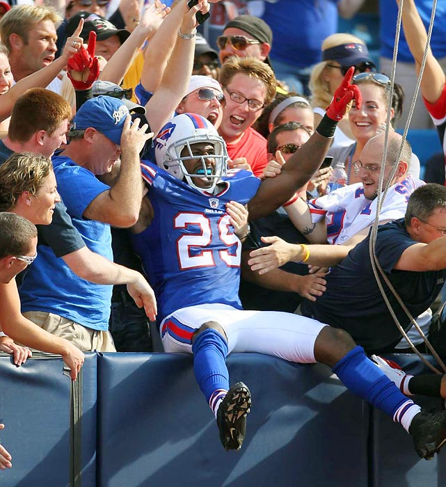 Buffalo's Drayton Florence celebrates with fans after returning one of Tom Brady's four interceptions for a touchdown.