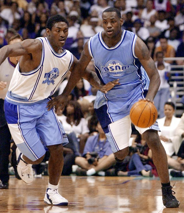 Ron Artest guards LeBron at Magic Johnson's All-Star Charity Game in 2003. James had 28 points, helping the rookies to a 127-123 victory.