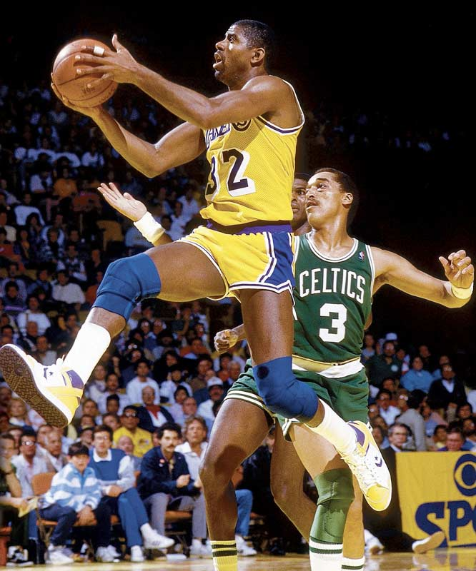 "Magic Johnson averaged a career-high 23.9 points and led the league with 12.2 assists as the ""Showtime"" Lakers won 65 games and reclaimed the NBA title from the Celtics. The Lakers, who had the league's most efficent offense, were loaded with Kareem Abdul-Jabbar and James Worthy in the frontcourt, Byron Scott joining Magic in the backcourt and the likes of Michael Cooper, A.C. Green and Mychal Thompson rounding out Pat Riley's rotation."