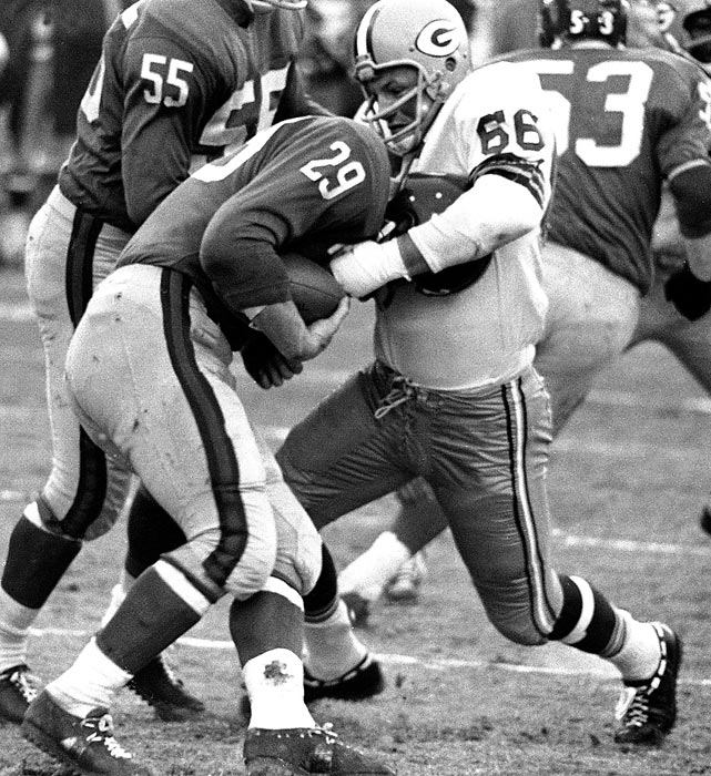 "Ray Nitschke grabs Giants running back Alex Webster by the head, prepared to flip him over if necessary. Nitschke was the Most Valuable Player in this game, recovering two fumbles, both leading to Packers scores, in harsh wintry conditions. He called it ""the most brutal football game that I have ever been in."""