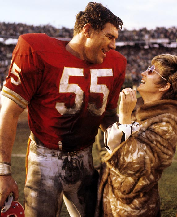A center's job usually brings more bruises and grime than glory.  After his team won the Super Bowl, center E.J. Holub reaps the glory along with the satisfaction of winning the big battle.