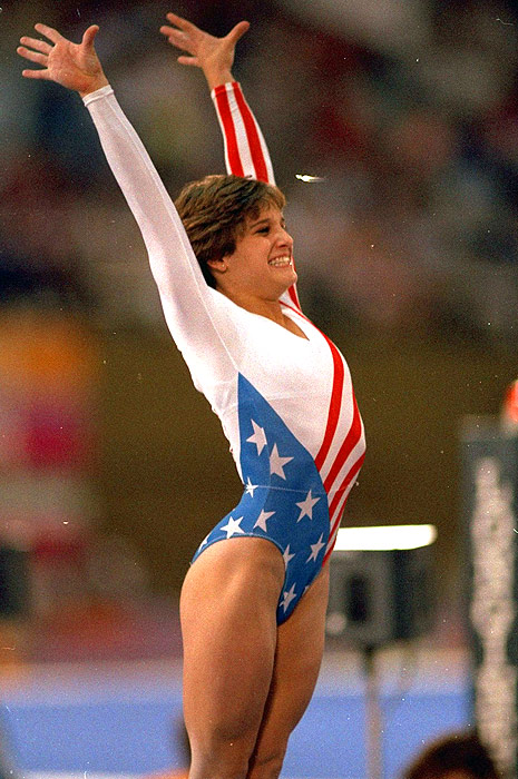 Mary Lou Retton captured America's heart during the 1984 Olympics in Los Angeles, when she became the first U.S. woman to win the Olympic all-around title. She scored perfect 10s on both her vault and floor routines, launching her by .05 of a point to take gold. That year, Retton was named Sports Illustrated's Sportswoman of the Year.