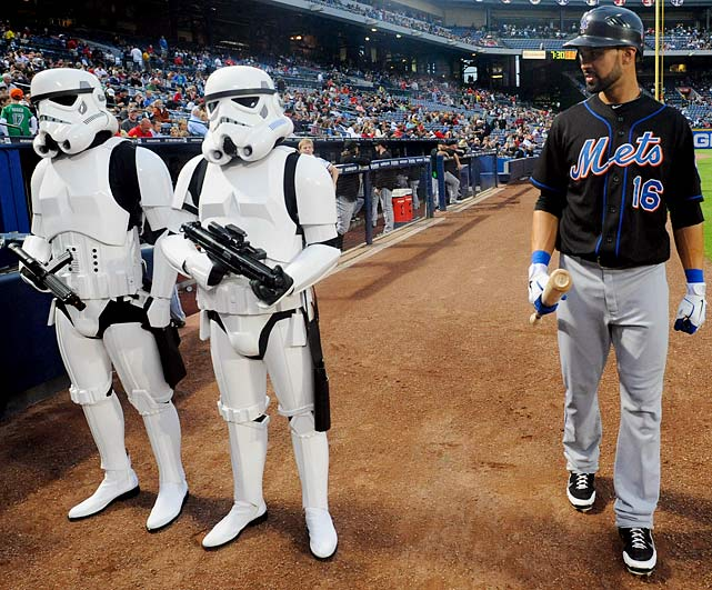 Mets center fielder Angel Pagan passes two stormtroopers before the start of a game against the Braves on Sept. 16, 2011 in Atlanta.
