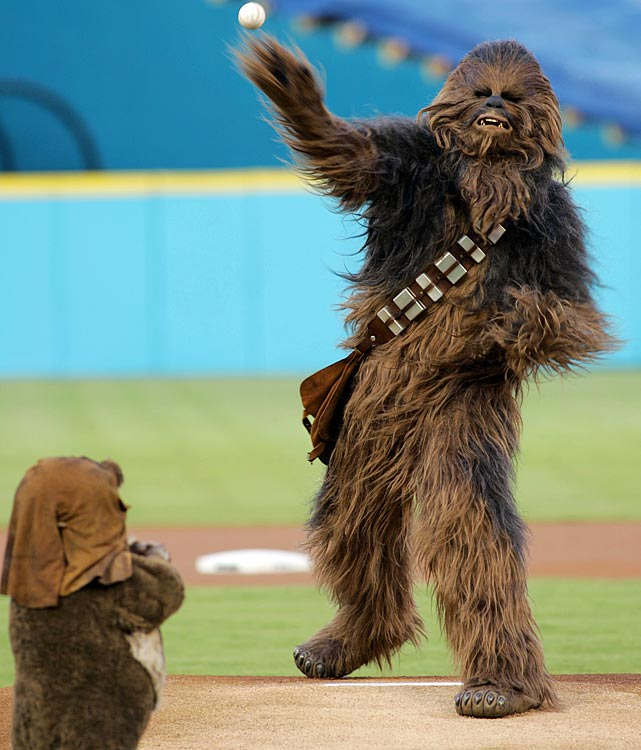Chewbacca throws out the ceremonial first pitch as Wicket the Ewok looks on before a game between the Marlins and Nationals on Aug. 22, 2006 in Miami.