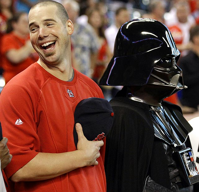 Cardinals pitcher Chris Carpenter laughs as he stands with Darth Vader before the National Anthem prior to a game against the Astros on Sept. 26, 2011 in Houston. It was Star Wars Night at Minute Maid Park.
