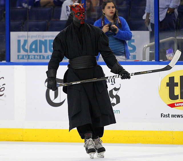 Darth Maul skates on the rink during a promotion between periods of a game between the San Jose Sharks and the Tampa Bay Lightning at the Tampa Bay Times Forum on Feb. 16, 2012.