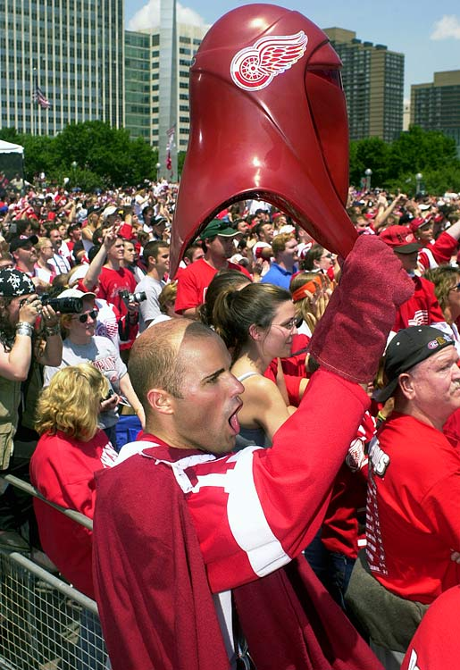 Red Wings fan Danny Beever, who modified his Star Wars Imperial Guard outfit into a Red Wings guard outfit, cheers during the team's Stanley Cup celebration rally on June 17, 2002 in Detroit.