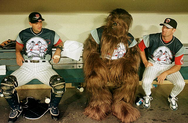 The Twins' Terry Steinbach (left) and Joe Mays share the bench with the Twins newest Wookie prior to their game with the Mariners on July 24, 1999 in Minneapolis.