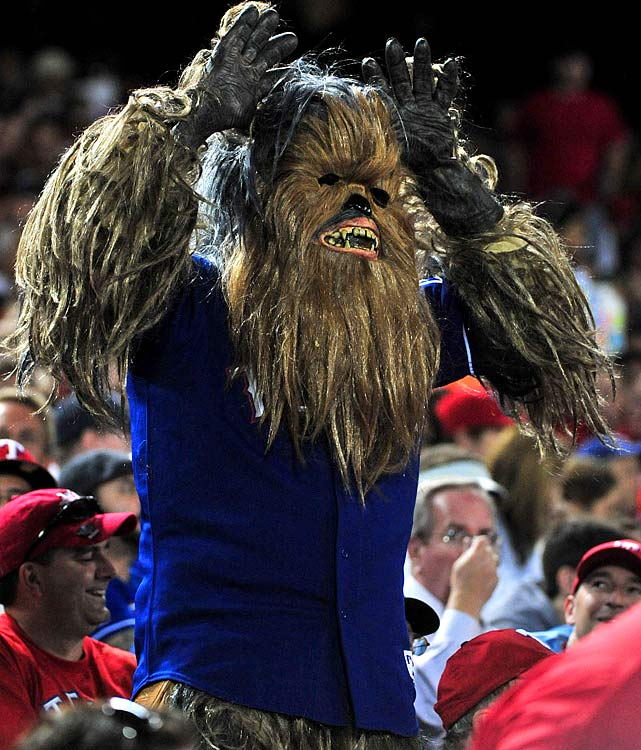 A Rangers fan dressed as Chewbacca cheers on his team as they play the Giants in Game 4 of the World Series on Oct. 31, 2010 at Rangers Ballpark in Arlington, Texas.
