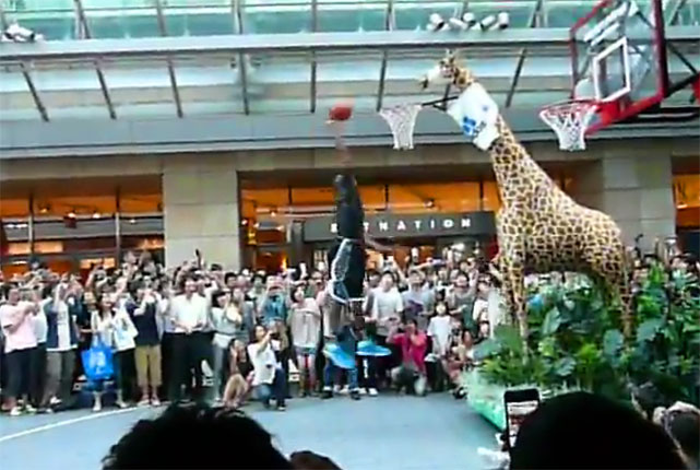 During a lengthy trip to Tokyo, Orlando center Dwight Howard was challenged to dunk on this giraffe hoop, which appears to be about a foot taller than the regulation-size hoop behind it. Why don't they have giraffe hoops in the All-Star Slam Dunk contest?