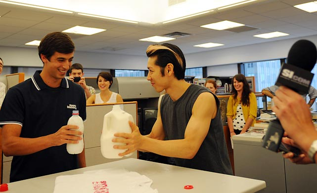 After barreling through the egg challenge, Kobayashi stepped up for a milk-chugging contest with SI.com's tennis producer, Chris Sesno. The playing field was leveled slightly as Sesno had to drink only 24 ounces to Kobayashi's gallon (128 ounces). It came down to the final gulps, but Kobayashi secured the victory (just moments after eating 32 hard-boiled eggs, mind you) after a costly last-second error from the challenger.