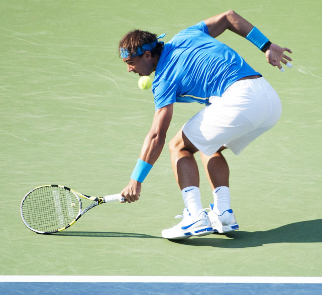 Nadal got a little tricky with a one-handed, about-face backhand against Nicolas Mahut.
