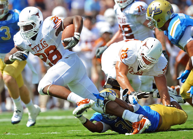 This was not what Rick Neuheisel needed. It was exactly what Mack Brown needed. New starter Case McCoy completed 10-of-14 passes for 167 yards, two touchdowns and no scores, but freshman tailback Malcolm Brown (pictured) carried the load, rushing 23 times for 114 yards and a score.