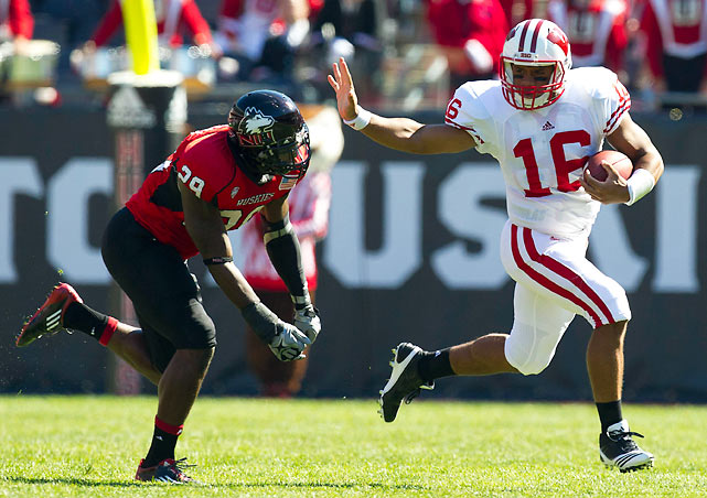 The Russell Wilson show continues. The Badgers' new quarterback (pictured) threw for 347 yards and three scores and Montee Ball rushed for another two touchdowns as Wisconsin piled up more than 600 yards of total offense in a rout of Northern Illinois. The Badgers have won 31 straight against nonconference opponents in the regular season.