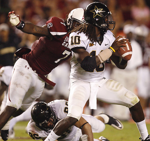 For the first time in his seven years at South Carolina, a Steve Spurrier team is 4-0. The Gamecocks beat Vanderbilt despite four interceptions from Stephen Garcia. The defense recovered two fumbles, both forced by freshman defensive end Jadeveon Clowney, and sacked Vanderbilt's quarterbacks six times. The Auburn Tigers visit Columbia next Saturday.