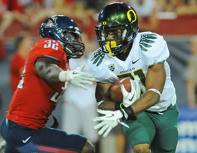 LaMichael James rushed for a school record 288 yards and broke the Oregon mark for career rushing touchdowns with two scores to lead the Ducks to a win over Arizona in their Pac-12 opener. Oregon won its 13th consecutive conference game, blowing open a 35-3 lead then holding off a Wildcats' rally before pulling away again with its lightning-quick offense.