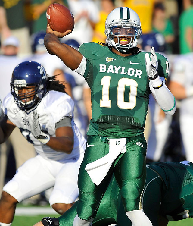 Robert Griffin III turned threw five touchdown passes, each to a different receiver, in leading Baylor to a victory over Rice. He came into the game leading the nation in passing efficiency and third in total yards, and went 29 of 33 for 338 yards, with another 51 yards and a touchdown rushing. He didn't even play the fourth quarter, leading Baylor to 56 points in just three periods.