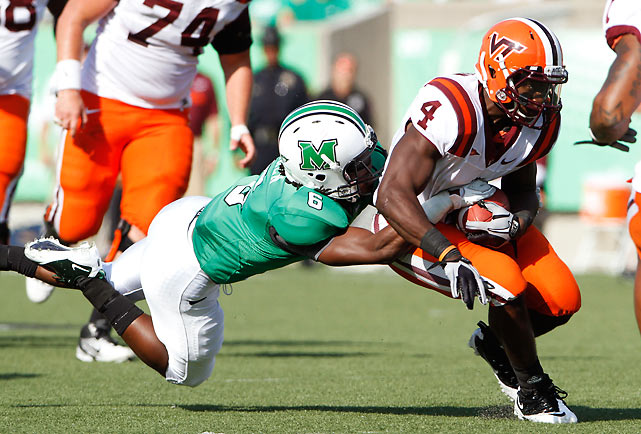 Virginia Tech continues to win while abstaining from blowing away inferior competition. Quarterback Logan Thomas was an efficient 22-of-32 for 228 yards, but failed to throw a touchdown pass. He got plenty of help from tailback David Wilson (pictured), who rushed for 132 yards and a score.