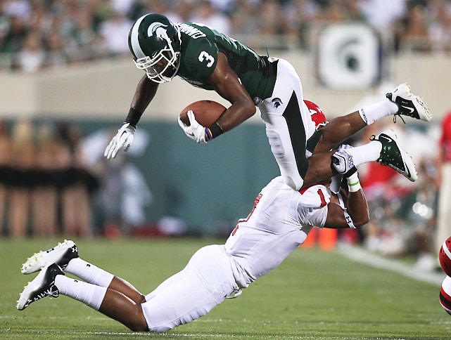 The Spartans got off to a slow start, committing seven first-half penalties. But it was smooth sailing once quarterback Kirk Cousins and receiver B.J. Cunningham got into a groove. Cunningham caught nine passes for 130 yards and a touchdown and moved into a tie for first-place on the school's career receptions list. Michigan State also got an emotional boost from offensive lineman Arthur Ray Jr., who played the opening snap after spending the last four years recovering from cancer in his left leg.