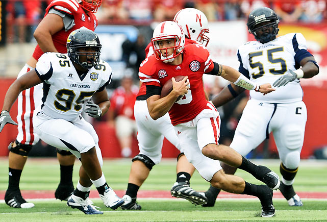 Taylor Martinez picked up where he left off before ankle injuries started marring his 2010 campaign, rushing for 135 yards and three touchdowns out of Nebraska's new no-huddle offense. Martinez, who matched his career high with 19 carries, also completed 11 of 22 passes for 116 yards. The win bodes well for the Huskers: Chattanooga has played against, and lost to, the last two national champions.