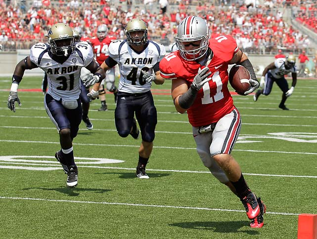 Jim who? The Buckeyes dominated all facets of play in the first game of the Luke Fickell era, outgaining Akron 29 first downs to five and 524 net yards to 90. Tight end Jake Stoneburner (pictured) was particularly efficient, delivering three touchdowns on four catches. Senior Joe Bauserman and freshman Braxton Miller both played well at quarterback, but Bauserman held an edge in attempts (16 to 12), passing yards (163 to 130) and passing touchdowns (three to one).