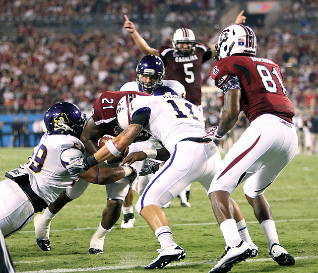 Marcus Lattimore (No. 21) ran for three touchdowns and Stephen Garcia (No. 5) rushed for two and threw for a third after sitting out the first quarter as the Gamecocks rolled. South Carolina, which trailed 17-0, rallied to help coach Steve Spurrier improve to 42-0 against schools outside the BCS automatic qualifying conferences.