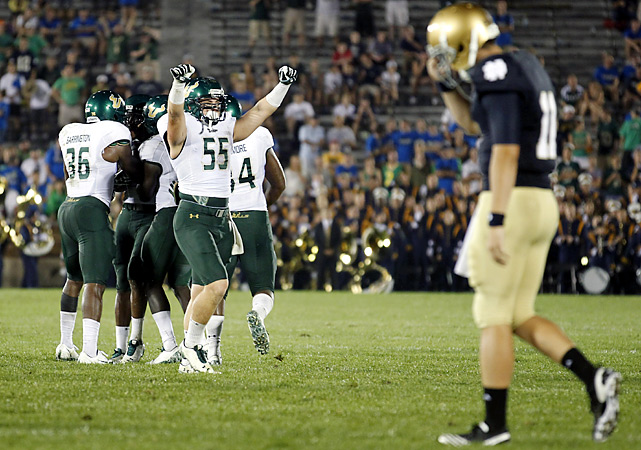 The Fighting Irish couldn't beat Mother Nature -- or the upstart Bulls. Kayvon Webster returned a fumble 96 yards for an early touchdown as South Florida came to Notre Dame for the first time and left a winner in a game disrupted for hours because of storms. USF coach Skip Holtz got an emotional victory in his return to Notre Dame, where he went to school and where his dad Lou led the Irish to their last national title in 1988.