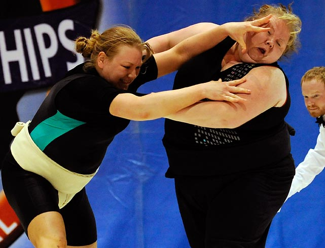 Natalie Burns (left) and Taunia Arave engage in the sumo version of a cat fight.