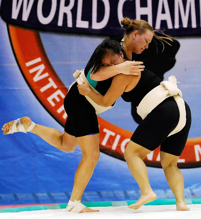 Natasha Ikejiri (right) tries a new fighting technique in which she smashes her face into her opponent's arm.